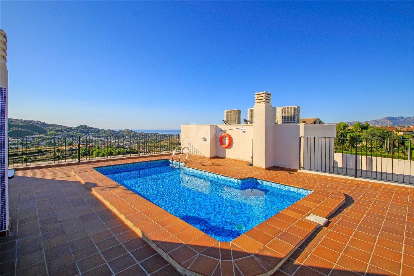 Het uitzicht op zee appartement te koop in Benitachell, Costa Blanca.